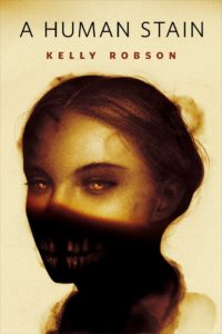 Cover of A Human Stain shows a woman in shadow with frightening teeth